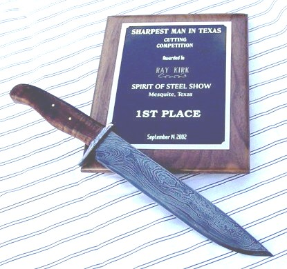 This damascus bowie was used to win the first Spirit of Steel cutting contest in September of 2002. I also used it to take the MS performance test and it broke a split second after I was told to stop. The next one passed with flying colors. Both were made of 300 plus layers of 52100 and 15N20. My favorite mix for contrast and performance.